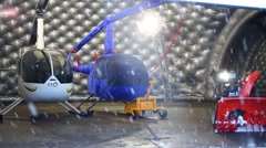 Hangar with two small helicopters and snowblower in Heliport Stock Footage