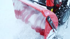 Rotating blades of working snowblower on a winter day Stock Footage