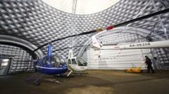 Helicopters in spacious hemispherical hangar of Heliport Moscow Stock Footage