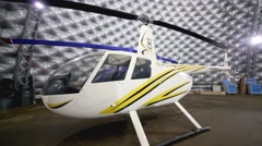 Small white helicopter in the hangar of Heliport Moscow Stock Footage