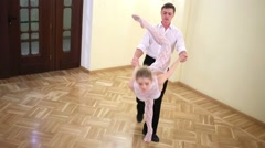 A pair of dancers in costumes performs an acrobatic trick Stock Footage