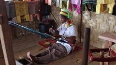Padaung (Karen) tribe woman weave on traditional device - stock footage