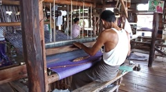 Weaving factory in Inle lake. A local man working on the loom(rear view side) Stock Footage