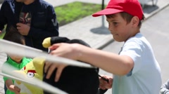 Boy plays Angry Birds game outdoor in Moscow. Stock Footage