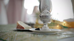 Smooth Footage of Traditional Orthodox Wedding Table with Crowns, Bread, Wine an Stock Footage
