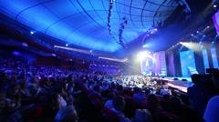 Spectators in blue light on Russian Music Award channel RUTV Stock Footage