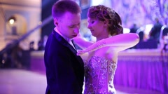 Beautiful couple in elegant dress takes position to waltz Stock Footage