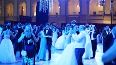 Dancing people in blue light at 11th Viennese Ball Stock Footage