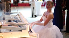 Girl in a wedding dress playing piano at 11th Viennese Ball Stock Footage