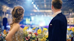Happy beautiful young couple near flowers at fandango Stock Footage