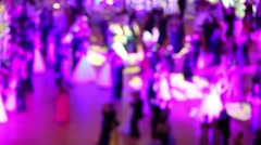Many happy waltzing people in pink light at ball out of focus Stock Footage