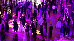 Dancing people under purple lights at 11th Viennese Ball Stock Footage