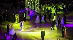 Waltzing people in colored lights at 11th Viennese Ball Stock Footage