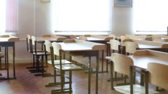 Classroom with rows of desks and chairs and windows Stock Footage