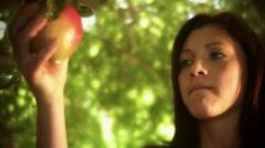 Eve picks fruit.mp4 Stock Footage