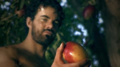 Adam eats fruit.mp4 Stock Footage