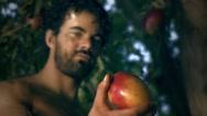 Stock Video Footage of Adam eats fruit.mp4