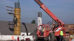 Foundation and underground work, steel worker climbing Stock Footage