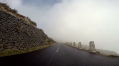 Driving mountain road inside clouds to Pico Arieiro in Madeira Stock Footage