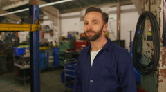 Portrait of a friendly car mechanic - stock footage