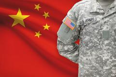 American soldier with flag on background - People's Republic of China - stock photo