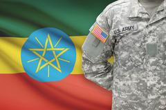 American soldier with flag on background - Ethiopia - stock photo