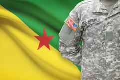 American soldier with flag on background - French Guiana - stock photo