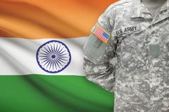 American soldier with flag on background - India Stock Photos