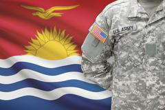 American soldier with flag on background - Kiribati - stock photo