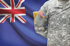 American soldier with flag on background - Turks and Caicos Islands - stock photo