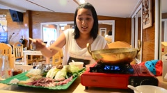 Thai women cooking Sukiyaki or Shuba Shabu or Hot Pot in restaurant Stock Footage