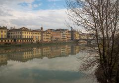Reflections on the Arno river in Florence - stock photo