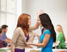 Two teenagers having a fight and getting physical Stock Photos