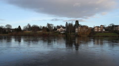 Riverside houses beside River Tay Perth Scotland Stock Footage