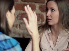 Two girlfriends fight, argue while sitting in cafe NTSC Stock Footage