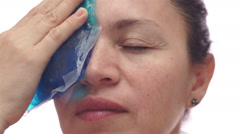 Woman With Cold Pack For Migraine - stock footage