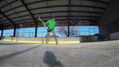 Super slow motion hockey slapshot Stock Footage