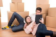 Happy couple with boxes - stock photo