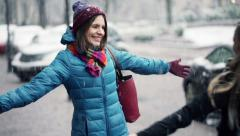 Young girlfriends meeting in the city in winter HD Stock Footage