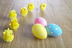 Stock Photo of multicolored easter eggs and chickens