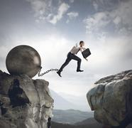 Businessman jumps the obstacle Stock Photos