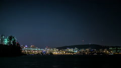 Stock Video Footage of Timelapse of Montreal Fireworks at Night over the Jacques-Cartier Bridge