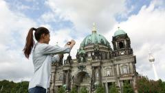 Tourist woman taking photograph in Berlin Germany Stock Footage