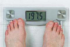 Checking Body Weight on Scale Stock Photos