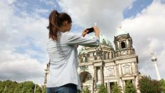 Travel woman taking photograph in Berlin Germany - happy tourist Stock Footage