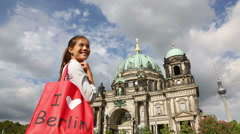Tourist in Berlin, Germany on travel with shopping bag Stock Footage