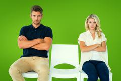 Composite image of young couple sitting in chairs not talking during argument - stock photo