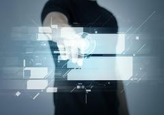 Man pointing his finger at virtual screen Stock Photos