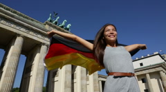 German flag woman happy at Berlin Germany by Brandenburger Tor Stock Footage