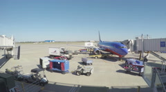 4K real time food truck pulling up to plane at gate Stock Footage